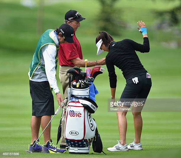 Michelle Wie of USA gest some instruction from coach David Leadbetter during the Pro Am prior to the start of The Evian Championship at the Evian...