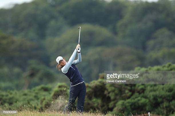 Michelle Wie of USA hits her approach shot on the 6th hole during the First Round of the 2007 Ricoh Women's British Open held on the Old Course at St...