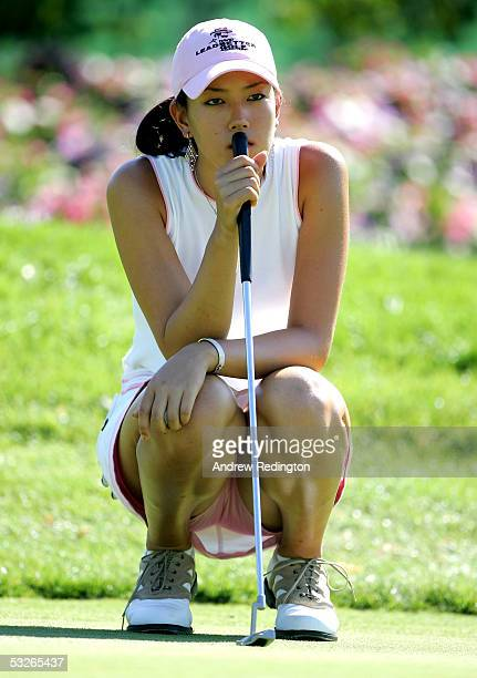 Michelle Wie of USA lines up a putt on the 18th green during the first round of the Evian Masters on June 20 2005 in Evian France