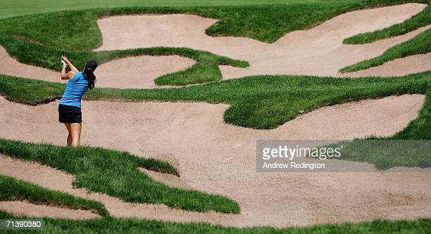 Michelle Wie of USA plays from a bunker on the fourth hole during the second round of the HSBC Women's World Match Play Championship at Hamilton Farm...
