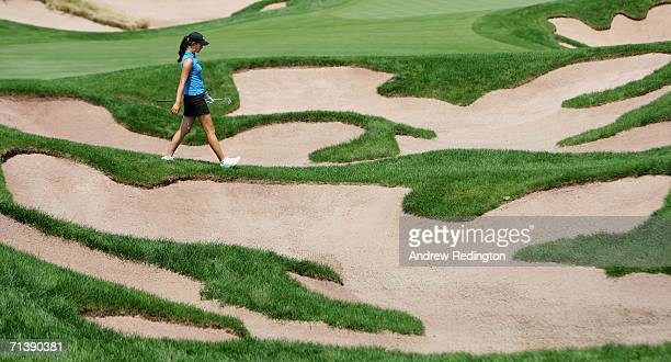 Michelle Wie of USA walks into a bunker on the fourth hole during the second round of the HSBC Women's World Match Play Championship at Hamilton Farm...