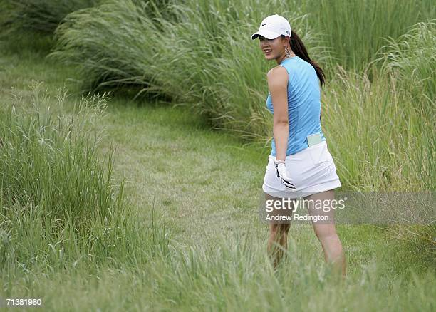 Michelle Wie of USA walks on the seventh hole during the first round of the HSBC Women's World Match Play Championship at Hamilton Farm Golf Club on...