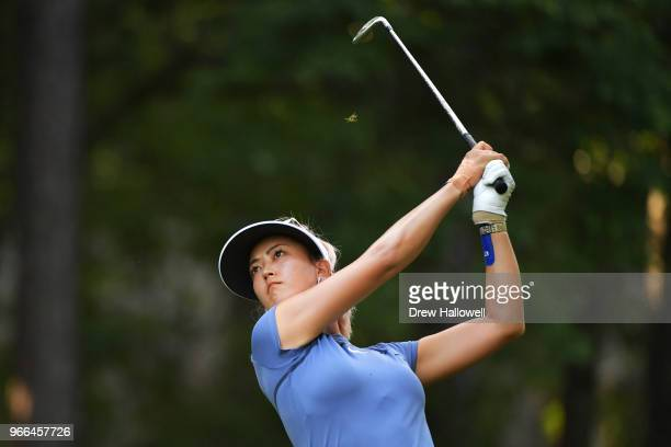 Michelle Wie plays her tee shot on the 13th hole during the third round of the 2018 US Women's Open at Shoal Creek on June 2 2018 in Shoal Creek...