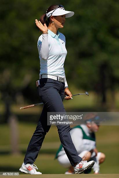 Michelle Wie reacts after holing an eagle putt on the 10th hole during Round One of the North Texas LPGA Shootout Presented by JTBC at the Las...