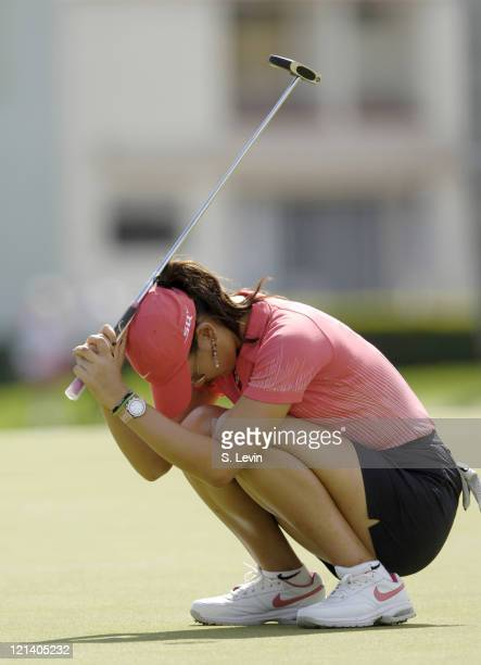 Michelle Wie reacts to her missed final putt during action at the Kraft Nabisco Championship at The Mission Hills Country Club in Rancho Mirage...