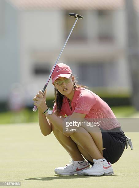 Michelle Wie reacts to her missed putt on the 18th green during action at the Kraft Nabisco Championship at The Mission Hills Country Club in Rancho...