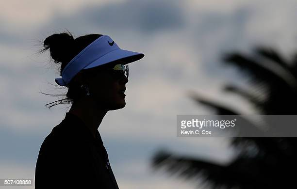 Michelle Wie walks down the fourth hole during the second round of the Pure Silk Bahamas LPGA Classic at the Ocean Club Golf Course on January 29...