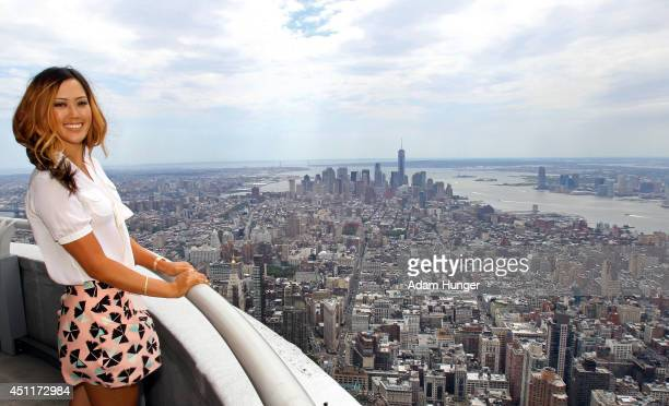 Michelle Wie winner of the US Women's Open poses for a photo on the 103rd floor of the Empire State Building during her Media Tour June 24 2014 in...