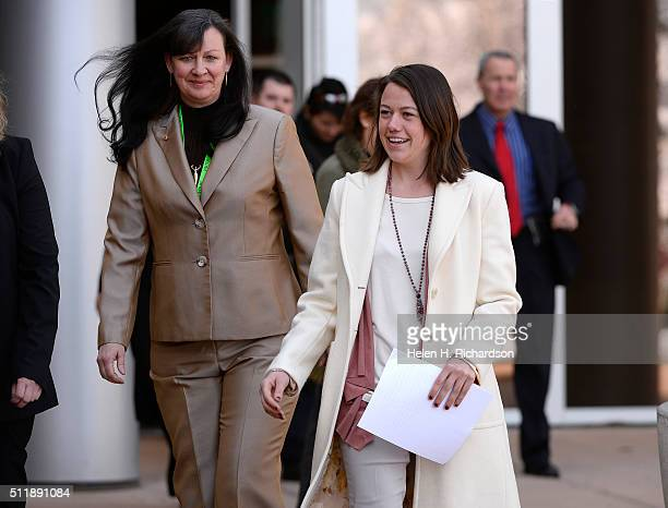 Michelle Wilkins right looks happy as she walks out of the Boulder County Courthouse with members of the Boulder district attorney's office to...