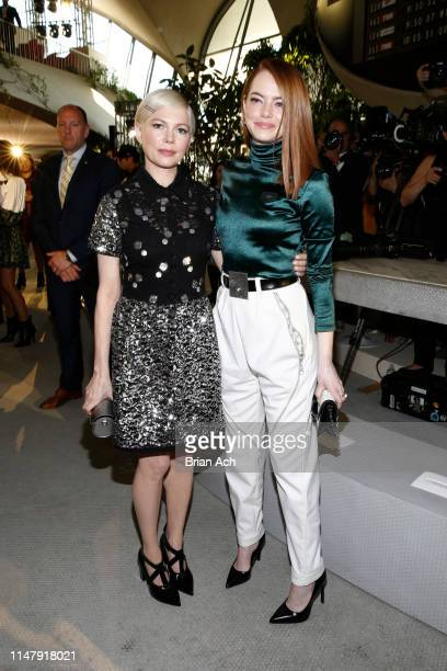Michelle Williams and Emma Stone attend the Louis Vuitton Cruise 2020 Fashion Show at JFK Airport on May 08 2019 in New York City
