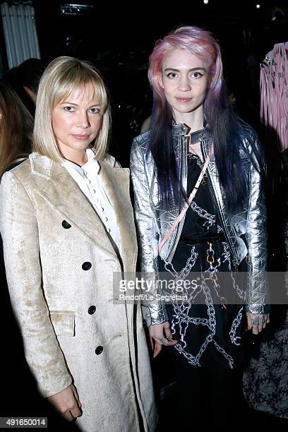 Michelle Williams and Grimes attend the Louis Vuitton show as part of the Paris Fashion Week Womenswear Spring/Summer 2016 Held at Fondation Louis...
