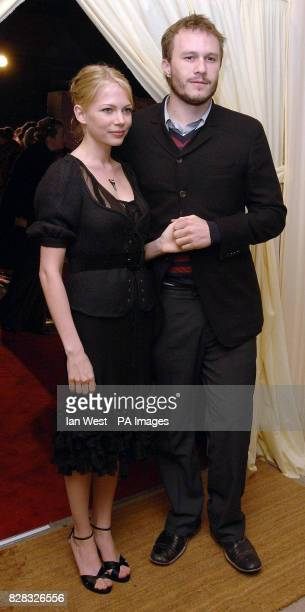 Michelle Williams and Heath Ledger arrive at the Pre Bafta London party hosted by UIP and Variety at Spencer House central London Saturday 18th...