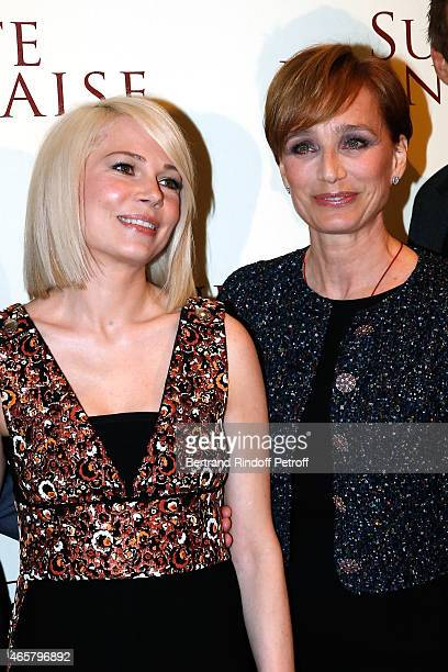 Michelle Williams and Kristin Scott Thomas attend the world premiere of 'Suite Francaise' at Cinema UGC Normandie on March 10 2015 in Paris France