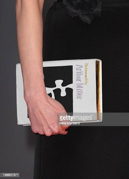Michelle Williams arrives carrying a book at the Orange British Academy Film Awards at The Royal Opera House on February 12 2012 in London England