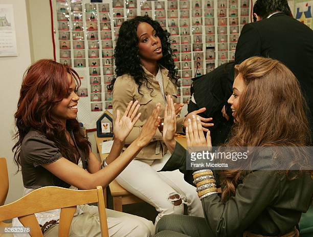 Michelle Williams Beyonce Knowles and Kelly Rowland of Destiny's Child get ready for their visit to the Ronald McDonald House April 13 2005 in...