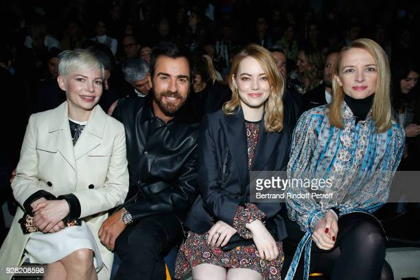 Michelle Williams Justin Theroux Emma Stone and Louis Vuitton's executive vice president Delphine Arnault attend the Louis Vuitton show as part of...