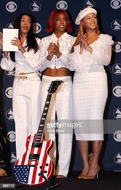Michelle Williams Kelly Rowland and Beyonce Knowles of Destinys Child attend a press conference for the 44th Annual Grammy Awards announcements...