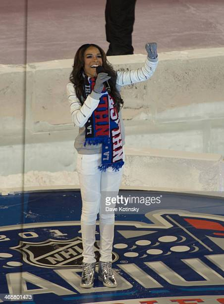 Michelle Williams performs performs the National Anthem at the 2014 NHL Stadium Series at Yankee Stadium on January 29 2014 in New York City