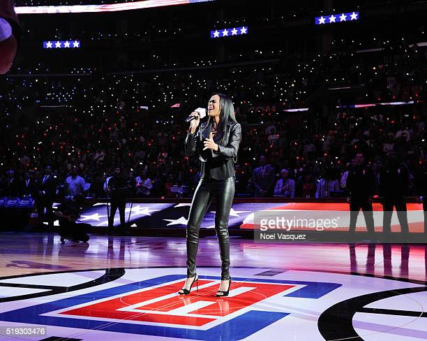 Michelle Williams performs the national anthem before a basketball game between the Los Angeles Lakers and the Los Angeles Clippers at Staples Center...
