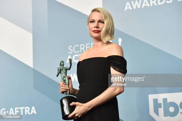 Michelle Williams poses in the press room after winning the award for Outstanding Performance by a Female Actor in a Television Movie or Limited...