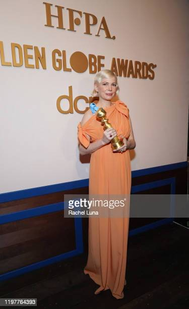 """Michelle Williams poses with Golden Globe award for Actress In A Mini-series or Motion Picture for TV for """"Fosse/Verdon"""" at the Official Viewing And..."""