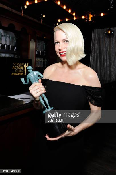 Michelle Williams, winner of Outstanding Performance by a Female Actor in a Television Movie or Miniseries for 'Fosse/Verdon', poses in the trophy...