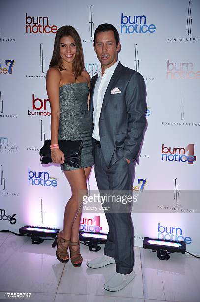 Michelle Woods and Jeffrey Donovan arrive at wrap party for Burn Notice at Fontainebleau Miami Beach on July 27 2013 in Miami Beach Florida