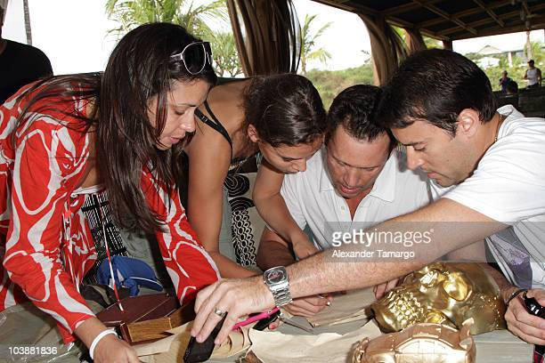 Michelle Woods and Jeffrey Donovan participate in the Jeep Chrysler scavenger hunt during Hollywood Dominos weekend on September 4, 2010 in Vieques,...