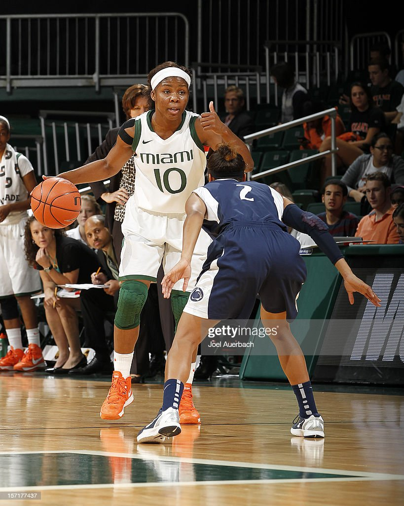 Michelle Woods #10 of the Miami Hurricanes dribbles the ball while being defended by Dara Taylor #2 of the Penn State Lady Lions on November 29, 2012 at the BankUnited Center in Coral Gables, Florida. Miami defeated Penn State 69-65.