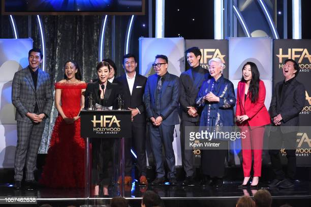 Michelle Yeoh and back Henry Golding, Constance Wu, Jimmy O. Yang, Ronny Chieng, Nico Santos, Harry Shum Jr., Lisa Lu, Awkwafina, and Ken Jeong...