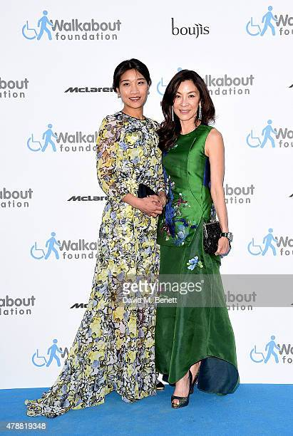 Michelle Yeoh and guest at the inaugural Walkabout Foundation gala drinks by Boujis London at Natural History Museum on June 27 2015 in London England