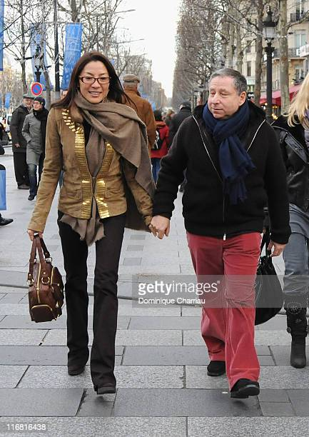 Michelle Yeoh and Jean Todt walk down the Champs Elysees before the premiere of the film 'Asterix at the Olympic Games' on January 14 2008 Paris...