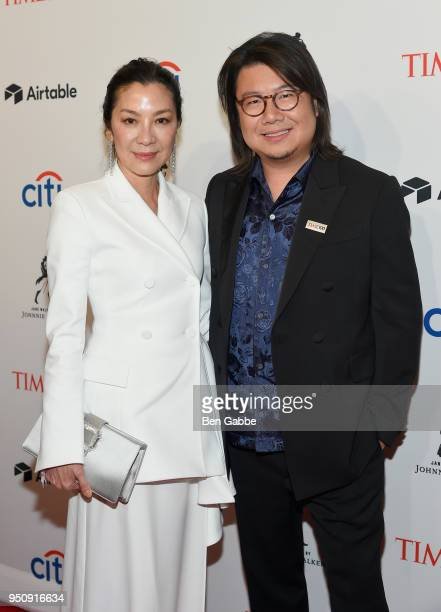 Michelle Yeoh and novelist Kevin Kwan attend the 2018 Time 100 Gala at Jazz at Lincoln Center on April 24 2018 in New York City