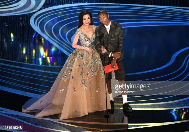Michelle Yeoh and Pharrell Williams speak onstage during the 91st Annual Academy Awards at Dolby Theatre on February 24 2019 in Hollywood California