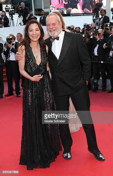 Michelle Yeoh and Terry Gilliam attend the Julieta premiere during the 69th annual Cannes Film Festival at the Palais des Festivals on May 17 2016 in...