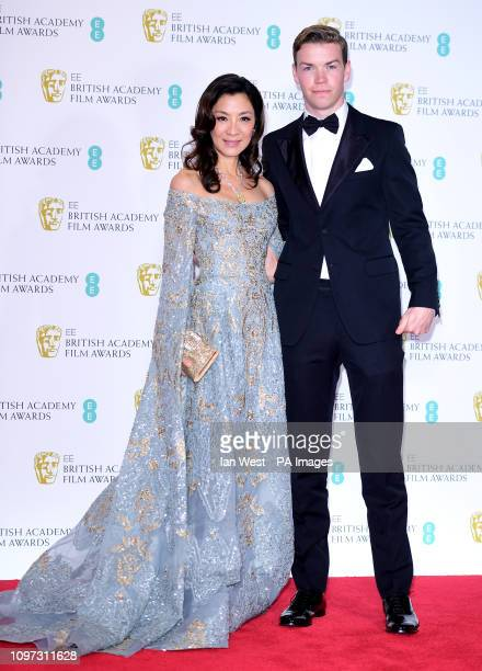 Michelle Yeoh and Will Poulter in the press room at the 72nd British Academy Film Awards held at the Royal Albert Hall Kensington Gore Kensington...