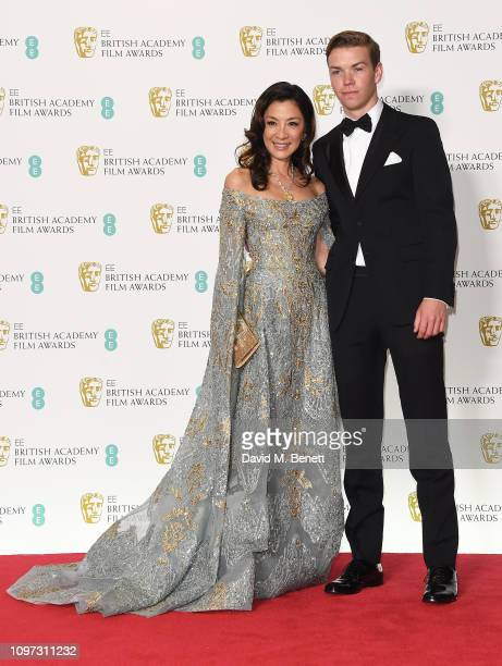 Michelle Yeoh and Will Poulter pose in the press room at the EE British Academy Film Awards at Royal Albert Hall on February 10 2019 in London England