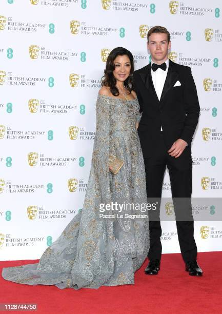 Michelle Yeoh and Will Poulter pose in the press room during the EE British Academy Film Awards at Royal Albert Hall on February 10 2019 in London...