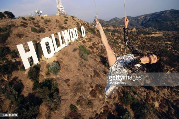 Michelle Yeoh in midair over the famous Hollywood sign in the afternoon in November of 1998 Michelle Yeoh born in Malaysia is now an internationally...