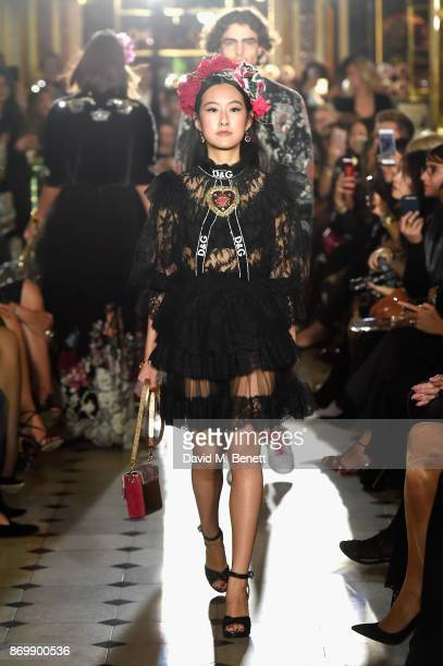 Michelle Yeoh walks the Dolce Gabbana Italian Christmas catwalk show at Harrods on November 2 2017 in London England