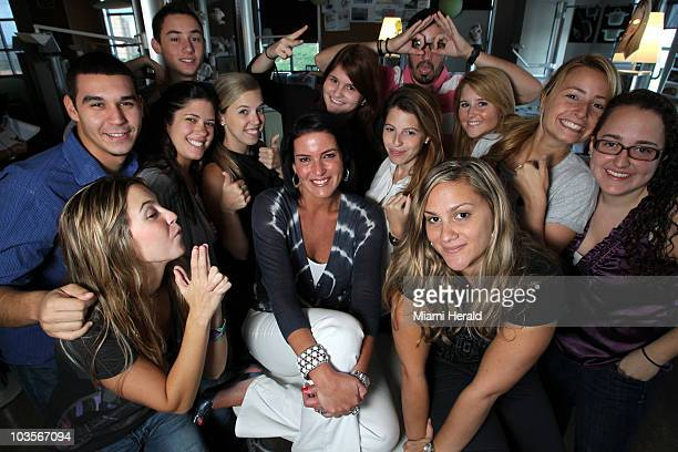 Michelle Zubizaretta, center, poses with several of her Gen-Y aged employees at her Zubi Adverstising in Coral Gables, Florida, on August 11, 2010.