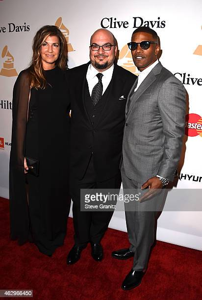 Michelle Zuiker producer Anthony Zuiker and actor Jamie Foxx attend the PreGRAMMY Gala and Salute To Industry Icons honoring Martin Bandier on...