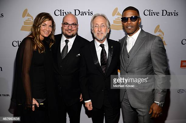 Michelle Zuiker producer Anthony Zuiker president of the National Academy of Recording Arts and Sciences Neil Portnow and actor Jamie Foxx attend the...