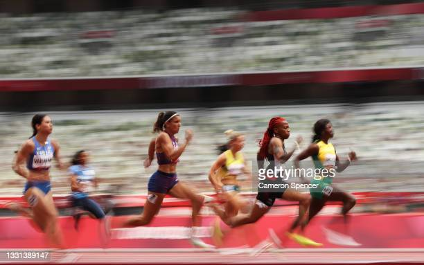 Michelle-Lee Ahye of Team Trinidad And Tobago competes during round one of the Women's 100m heats on day seven of the Tokyo 2020 Olympic Games at...