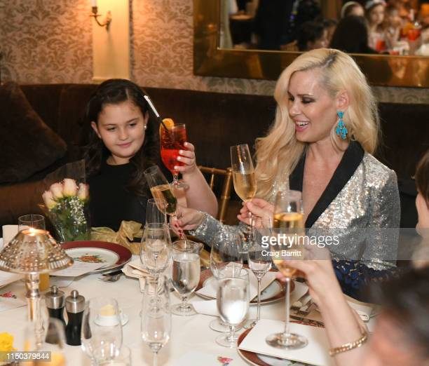 MichelleMarie Heinemann and daughter Hyacinth Cornelia Heinemann attend Hyacinth Cornelia Heinemann Communion Dinner at The Carlyle Hotel on May 19...