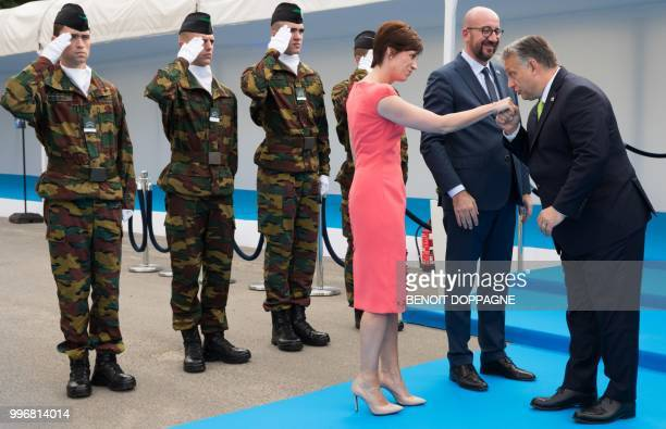 PM Michel's partner Amelie Derbaudrenghien Belgian Prime Minister Charles Michel and Hungary Prime Minister Viktor Orban greet each other as they...