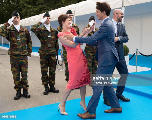 PM Michel's partner Amelie Derbaudrenghien Prime Minister of Canada Justin Trudeau and Belgian Prime Minister Charles Michel greet each other as they...