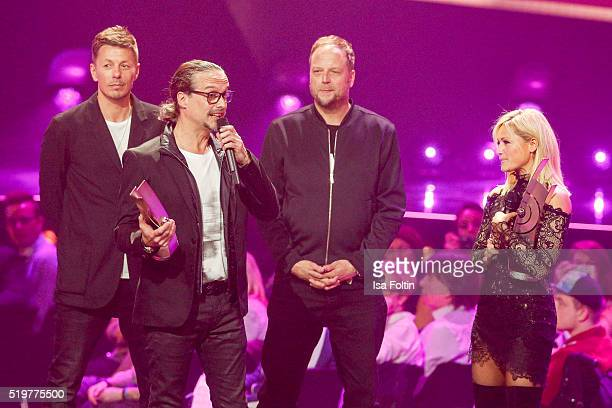 Michi Beck and Smudo from band 'Die Fantastischen Vier' are seen on stage with the award winners Alex Christensen and Helene Fischer during the Echo...