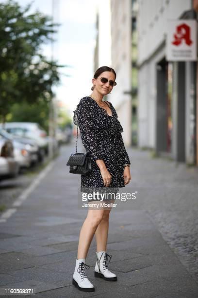 Michi Brandl wearing a Miu Miu sunglasses via Sunglass Hut Chanel bag on July 01 2019 in Berlin Germany