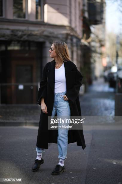 Michi Brandl wearing white Toteme top, black Zara coat, Levis blue jeans, Kapten & Son shades, black Chanel leather bag, Balenciaga socks and black...
